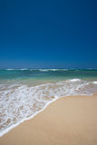 Wave surging on sand. Wave surging on beach sand Stock Photos