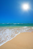 Wave surging on sand Royalty Free Stock Photo