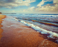 Wave surging on sand Stock Photo