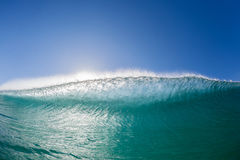Wave Swimming Confrontation. Ocean wave wall surfer swimming view inside hollow crashing blue water face to face closeup Stock Photography