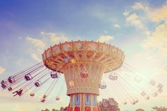 Wave Swinger ride against blue sky Royalty Free Stock Photo