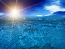 Wave  tsunami   sea  ocean. Disaster a tsunami wave in the sea against the sun and the cloudy sky on horizon Stock Image