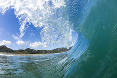 Wave Tubing, North Piha, New Zealand Stock Photo