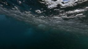 Wave underwater slow motion breaking. stock footage