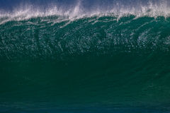 Wave Upright Details. Large Wave with the wall in light texture ,color and contrast pitches and surges towards the reef and shoreline. The color photo image Stock Photo