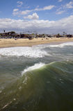 Wave. A view from above and behind a wave rolling ashore Stock Photography