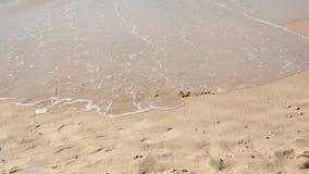 Wave washing Love Stock Image