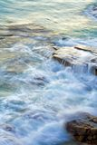 Wave washing on rocks Royalty Free Stock Photo