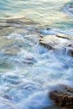 Wave washing on rocks. Wave washing on Boiling Pot Rocks, Noosa, Queensland, Australia, using a long exposure to blur water Royalty Free Stock Photo