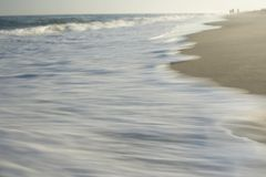 Wave washing on shore blurred motion Stock Image