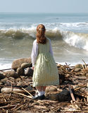 Wave watching. Girl looking out at waves Royalty Free Stock Photos