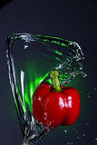 Wave of water on a pepper. Royalty Free Stock Images