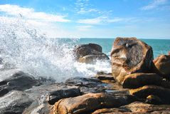 A wave of water refreshing a stone royalty free stock images