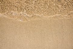 Wave of water on sand beach Royalty Free Stock Photo