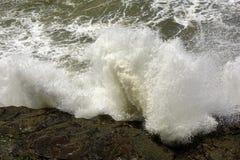Wave. S crashing force against the rocks Stock Image