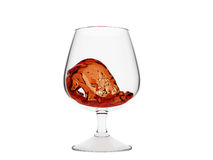 Wave of whiskey in glass Stock Photos