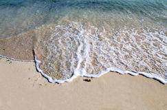 Wave on white sand Royalty Free Stock Photos