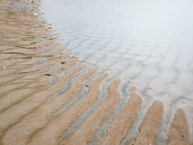Wave and wind create texture of sand sea Stock Image