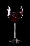 Wave of wine in wineglass Stock Photography