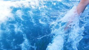 Wave from yacht. Foot girl cuts the waves of boat traffic stock footage