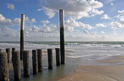 Wavebreaker at low tide. Wavebreakers on the Dutch beaches in the province of Zeeland prevent the sand flowing away into the sea during high tide stock image