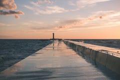 Wavebreaker in the sea - vintage effect. Wavebreaker in the sea with waves crushing over in sunset - vintage effect Stock Photo