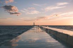 Wavebreaker in the sea - vintage effect. Wavebreaker in the sea with waves crushing over in sunset - vintage effect Stock Photography