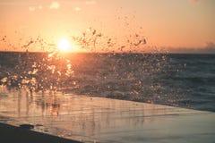 Wavebreaker in the sea - vintage effect. Wavebreaker in the sea with waves crushing over in sunset - vintage effect Royalty Free Stock Photo