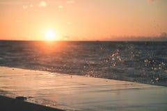 Wavebreaker in the sea - vintage effect. Wavebreaker in the sea with waves crushing over in sunset - vintage effect Royalty Free Stock Photos