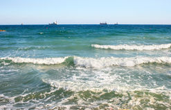 Waves. In blue sea,ships Royalty Free Stock Images