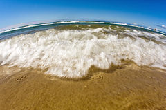 Waves. Gentle rolling waves on a sandy beach Royalty Free Stock Photo
