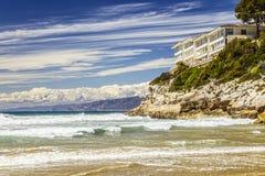 Waves. Big house on the seashore Royalty Free Stock Image