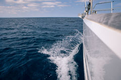 Waves from aboard a sailing boat at sea Royalty Free Stock Image