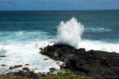 Waves against black lava rock in hawaii Stock Photos