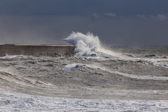 Waves against harbor wall Stock Photography
