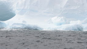 Waves against iceberg, rough seas stock video footage