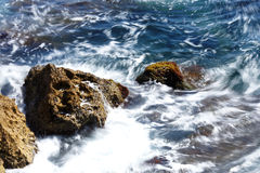 Waves against the rocks. Waves breaking against the rocks Royalty Free Stock Photo