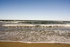 Waves along sandy beach Royalty Free Stock Image