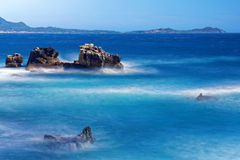 Waves around rocks. In front of a coastal town in the South of France Stock Photography
