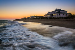 Waves in the Atlantic Ocean and beachfront homes at sunset, Edis Stock Photo
