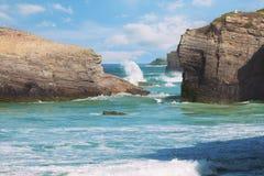 Waves of the Atlantic Ocean break about coastal rocks Royalty Free Stock Photo