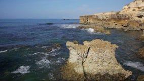 Waves of the Atlantic Ocean break about coastal rocks stock video