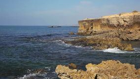 Waves of the Atlantic Ocean break about coastal rocks stock video footage