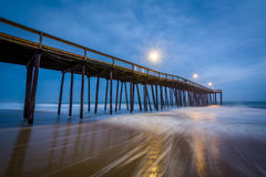 Waves in the Atlantic Ocean and the fishing pier at twilight, in. Ocean City, Maryland Stock Photos