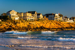 Waves in the Atlantic Ocean and houses on cliffs in York, Maine. Stock Photo