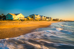 Waves in the Atlantic Ocean and morning light on beachfront home Stock Images