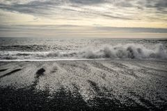 Waves on the Atlantic Ocean off the coast of Iceland, black beach. stock photo