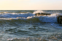 The waves of the Baltic Sea breaking on the old wooden german br Stock Photography