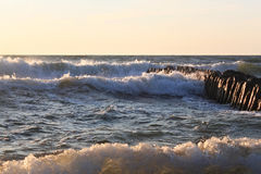 The waves of the Baltic Sea breaking on the old wooden german br Royalty Free Stock Images