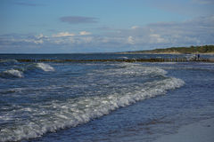 The waves of the Baltic sea. Are rolled out on a sandy beach Stock Photo